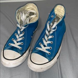 Blue and white high top converse